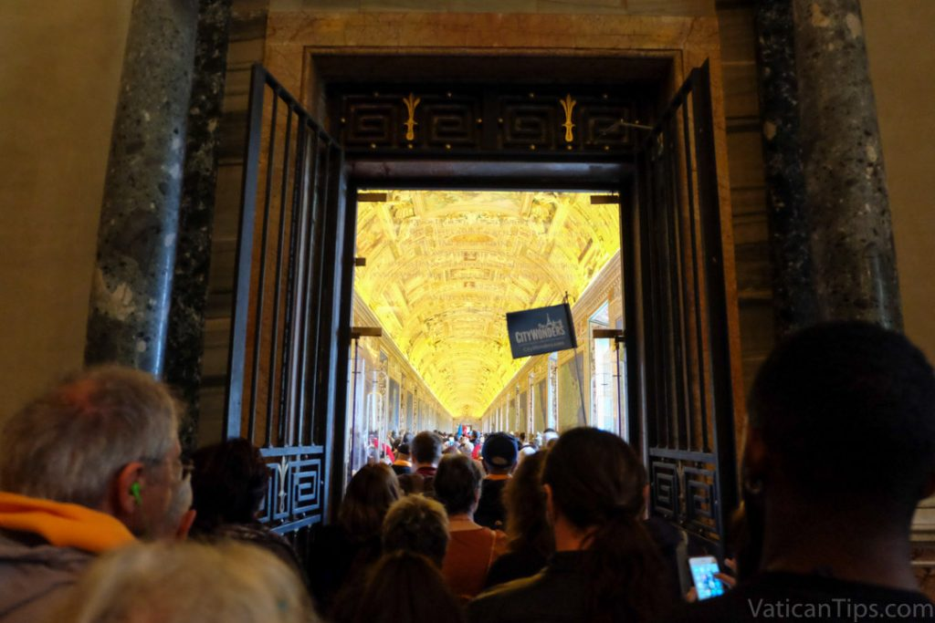 people entering the hall of maps at the Vatican