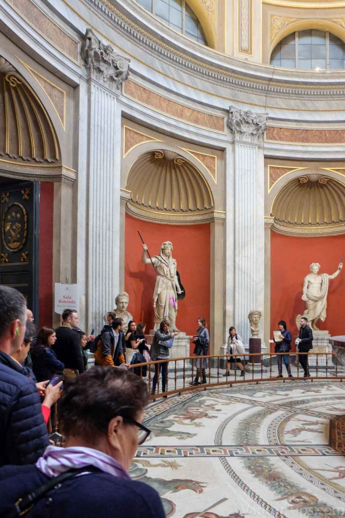 statues and floor in round room